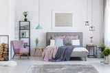 Pastel bedroom with comfortable chair - 174681452