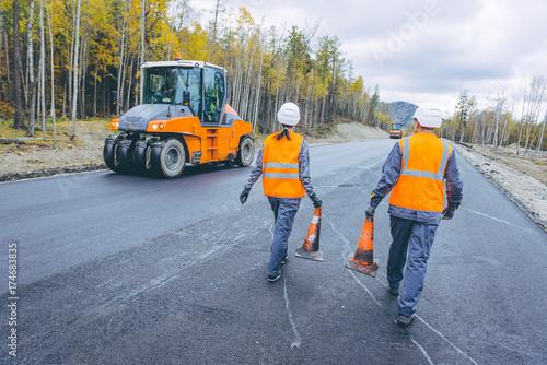 cone worker asphalting