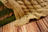 Part of hand knitted cloth lying in a wooden box on a table - 174686428