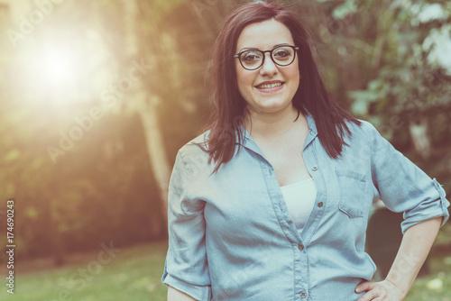 Portrait of happy pretty young brunette, light effect