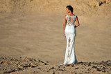 Woman or girl in white sexy dress standing in dunes - 174693693