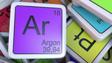 Argon block on the pile of periodic table of the chemical elements blocks. Chemistry related 3D rendering - 174696881