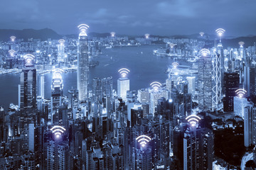 Wifi icon and Hong Kong city with wireless network connection. Hong Kong smart city and wireless communication network, abstract image visual, internet of things. © ake1150