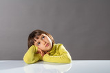 sweet pouting thinker looking away for concept of kid boredom - 174705800