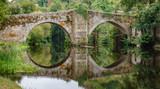 River and medieval bridge in Allariz, Orense, Spain - 174725411