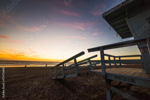Lifeguard hut in Santa Monica beach at sunset Poster
