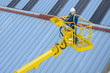 builder on a yellow aerial platform