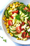 Colorful Vegetable Salad with Herbs in a Bowl - 174774839