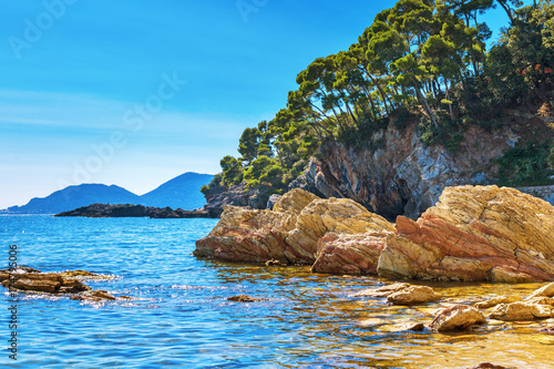 Foto op Aluminium Blauw Coast with huge stones and rock. Steep coast. Rocky beach.