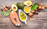 Selection food sources of omega 3 and unsaturated fats. Superfood high vitamin e and dietary fiber for healthy food. Almond,pecan,hazelnuts,walnuts,olive oil,fish oil and salmon on wooden background. - 174808808