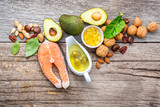 Selection food sources of omega 3 and unsaturated fats. Superfood high vitamin e and dietary fiber for healthy food. Almond,pecan,hazelnuts,walnuts,olive oil,fish oil and salmon on wooden background. - 174808859