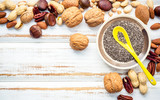 Selection food sources of omega 3 and unsaturated fats. Superfood high vitamin e and dietary fiber for healthy food. Mixed nuts almond ,pecan,hazelnuts,walnuts and various beans on white background.. - 174809243