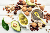 Selection food sources of omega 3 and unsaturated fats. Superfood high vitamin e and dietary fiber for healthy food. Almond ,pecan,hazelnuts,walnuts and olive oil on stone background. - 174809263
