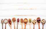 Selection food sources of omega 3 and unsaturated fats. Superfood high vitamin e and dietary fiber for healthy food. Mixed nuts almond ,pecan,hazelnuts,walnuts and various beans on white background. - 174809427