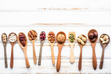 Selection food sources of omega 3 and unsaturated fats. Superfood high vitamin e and dietary fiber for healthy food. Mixed nuts almond ,pecan,hazelnuts,walnuts and various beans on white background. - 174809461