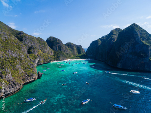 Fotobehang Nachtblauw Top Aerial view of tropical island with limestone rocks, white beach and blue clear water. Maya bay with many boats and speedboats above coral reef. Phi-Phi Islands, Krabi, Thailand.