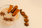 Indian masala tea with spices and milk on white background. - 174827050