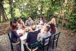 Quadro Friends having dinner in garden