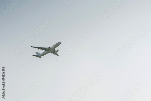 White airplane profile plane climb up the height of cloud sun glare blank no lab Poster