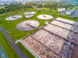 Aerial view to sewage treatment plant in green fields. Grey water recycling. Waste management for 165, 000 inhabitants of Pilsen city in Czech Republic, Europe.  - 174879691