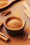 Pile of cinnamon sticks and powder on brown rustic background. Aromatic spices. - 174901402