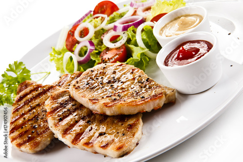 Poster Steakhouse Grilled steaks and vegetable salad on white background