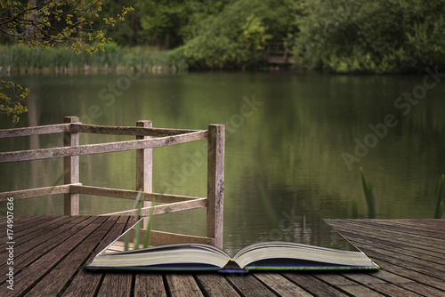 Plexiglas Pier Shallow depth of field landscape image of vibrant peaceful Summer lake in English countryside concept coming out of pages in open book
