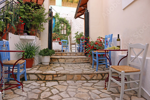 Wine and grapes on the table street in Parga Greece
