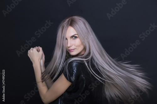 Aluminium Kapsalon Beautiful Blue Eyes of Young Woman.Blond girl.close-up.Art portrait.Beautiful healthy hair.Beauty salon.flying hair
