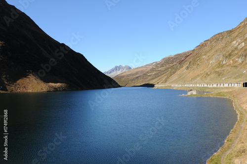In de dag Bergen Stausee am Oberalp PAss. Lake at the Oberalp Pass in the swiss alps.