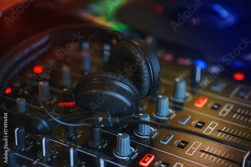 DJ mixer in bright colors disco in a nightclub. Poster