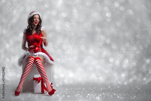 Girl unwrapping christmas present