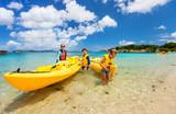 Family kayaking at tropical ocean - 174926649