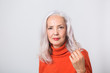 Pretty stylish grey haired woman in a red sweater