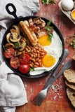 Traditional english breakfast. Pan with full english breakfast overhead rustic wooden table. Overhead view. - 174932416