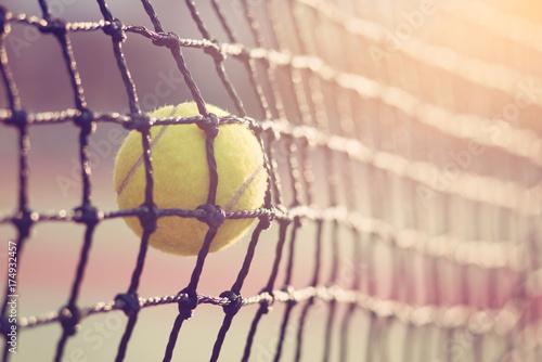 Fotobehang Tennis Tennis ball hitting the tennis net at tennis court with copy space.