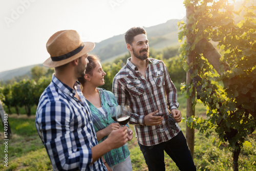 Wine grower and people in vineyard