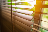 Wooden blinds with sun light. - 174933648