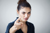 Angry woman pointing isolated on gray background - 174937217