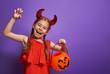 little devil with a pumpkin