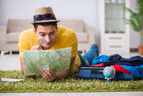Man planning his vacation trip with map - 174943276