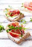 Sandwich with serrano ham, cream cheese and arugula - 174943806