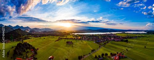 Foto op Aluminium Panoramafoto s Panorama from the air sunset Forggensee and Schwangau, Germany, Bavaria