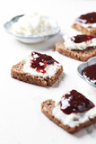 Canapes with cherry marmalade and soft cheese - 174946847
