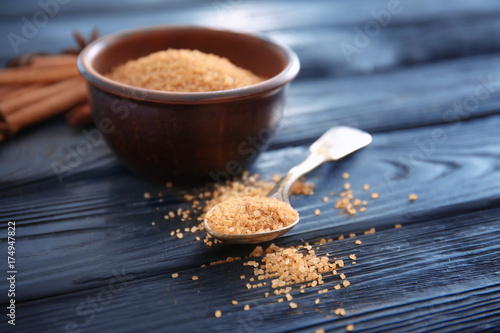 Fotobehang Kruiden 2 Bowl and spoon with cinnamon sugar on wooden table