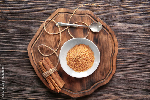 Fotobehang Kruiden 2 Sweet cinnamon sugar and sticks on wooden background