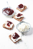 Canapes with cherry marmalade and soft cheese - 174948493