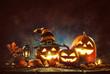 Leinwandbild Motiv Candle lit Halloween Pumpkins