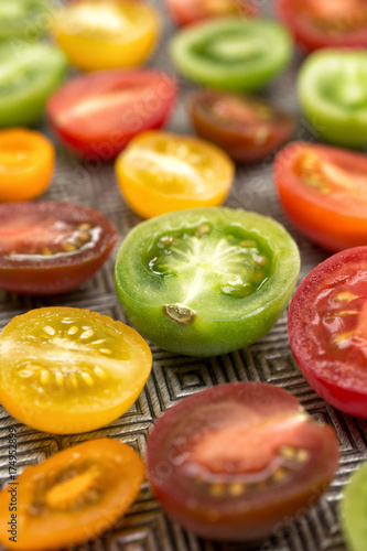 Fotobehang Kersen Colorful tomatoes on a plate