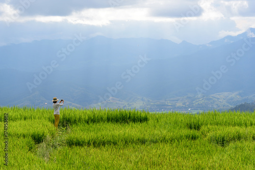 Fotobehang Rijstvelden Woman enjoy view of rice field and landscape of mountain area in Chiangmai northern Thailand